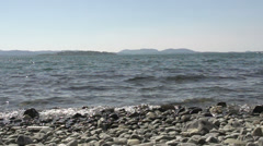 0116Norway beach lakeview rocks slowmotion Stock Footage