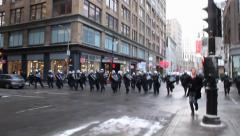 Riot police officers running after rioters Stock Footage
