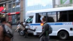 """Protester with """"no pigs"""" sign kicks police car Stock Footage"""