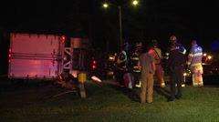 Overturned semi truck and trailer night MS Stock Footage