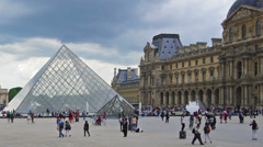 France, Paris, clouds on sky over Louvre, time-lapse, zoom out. Stock Footage