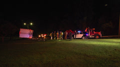 Overturned semi truck and trailer night WS Stock Footage