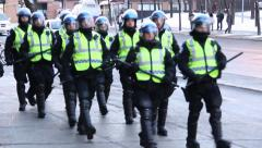 Riot police team marching and patrolling Stock Footage
