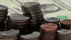 pan across cents and dollars left to right - stock footage