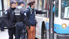 Protesters arrested and put into public bus - stock footage