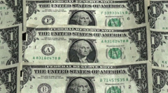 Pan view over one dollar bills Stock Footage