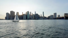 View of Manhattan with water and sailboat Stock Footage