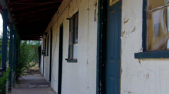 Row Of Generic Motel Room Doors At Cheap Rundown Motel Stock Footage