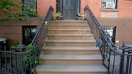 Stock Video Footage of Establishing shot of brownstone building from stairs