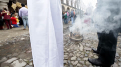 Stock Video Footage of Smoke of incense being burned on a thurible at cermony on the streets