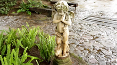 An angel statue in front of a fountain. Stock Footage