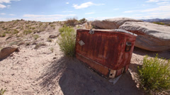 Abandoned Cooler in Desert Badlands with Drought Front Angle Stock Footage