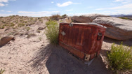 Stock Video Footage of Abandoned Cooler in Desert Badlands with Drought Front Angle