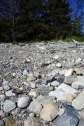granite pebbles form the beach - stock photo