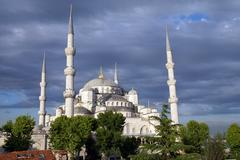 sultan ahmet camii ( blue mosque ) glows in early evening light - stock photo