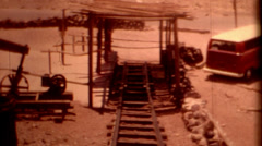 1960 parking lot at Calico Ghost Town cars train tracks vintage film historic Stock Footage