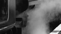 B&W Steam train close up of moving wheels and steam billows Stock Footage