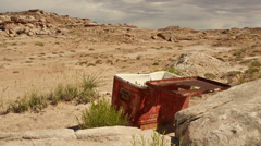 Abandoned Cooler in Desert Badlands with Drought Stock Footage