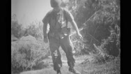 Military soldier searching for punji traps and VC tunnel Stock Footage