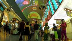 Walking Fremont Street Past Costumed Performers- Las Vegas Nevada Stock Footage