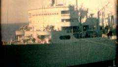 8mm film 1960s pan of  a battleship in open waters vintage film historic Stock Footage