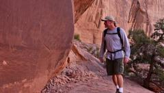 Hiker Finds Petroglyphs Native American Rock Art Prehistoric Archeology Stock Footage
