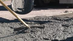 Freshly poured concrete is raked prior to trowel work Stock Footage