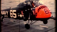 Film of a Piasecki helicopter landing aircraft carrier 1960s vintage military  Stock Footage