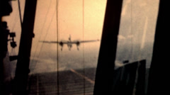 Film plane landing on aircraft carrier 1960s vintage film historic military Stock Footage