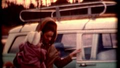 Film of female with kids blue station wagon people 1960s vintage film fashion Stock Footage