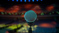 Microphone on stage, colorful spotlights Stock Footage