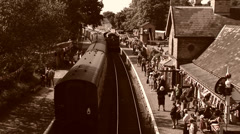 Old style shot of Steam train arriving into station Stock Footage