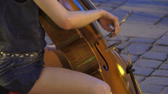 Attractive female street musicians performing cello concert Stock Footage