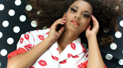 Fashion beauty portrait of young black beautiful model lying on dots pattern. Stock Footage