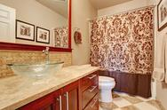 Stock Photo of modern bathroom interior in soft brown tones