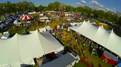 Day-time Festival Flyover [Aerial] Stock Footage