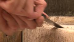 Male hands using putty knive to clean debris from surface Stock Footage
