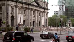 4K UHD - Busy street corner with old and new building in contrast in background Stock Footage