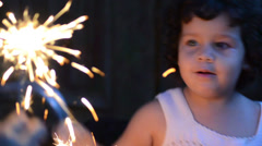 Kid playing with fireworks as a fairy 01 Stock Footage