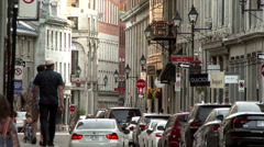 4K TV Demo - People walking in old european streets with bricks and stone walls Stock Footage
