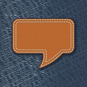 Stock Illustration of leather speech bubble on jeans texture