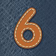 Number 6 made from leather on jeans background Stock Illustration