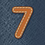 number 7 made from leather on jeans background - stock illustration