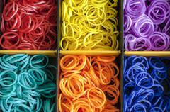 colorful rainbow loom rubber bands in a box - stock photo