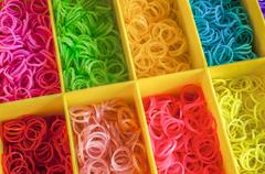 Colorful rainbow loom rubber bands in a box Stock Photos