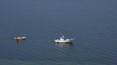 Coast rescue ship setting beacons along the shore. La Manga, Spain. Stock Footage