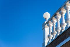 Ornate white railing - stock photo