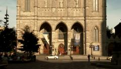 4K UHD - People walking in front of massive centuries old cathedrale Stock Footage