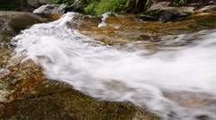Fast flowing waters of waterfall in thailand Stock Footage
