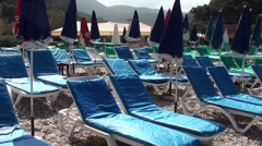 Sun loungers and umbrellas no people Stock Footage